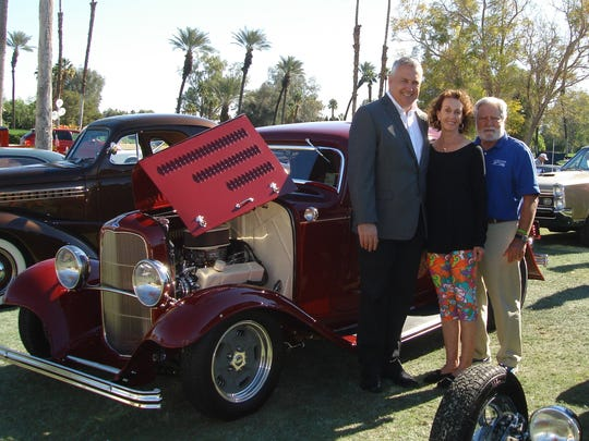 (left to right) General Manager of Mission Hills Country Club Garret Kriske, Scholars Charity Classic Chair Marlene O'Sullivan, and Bill O'Sullivan who organized the Invitational Car Show.