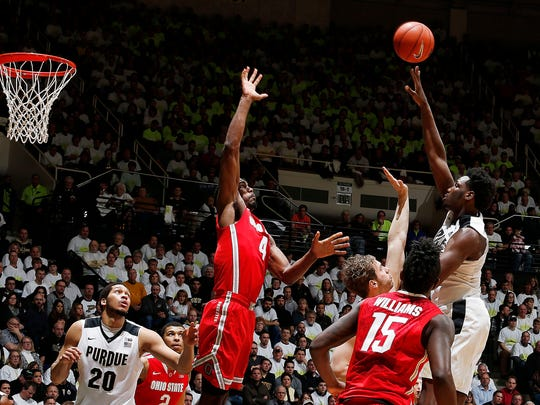 Boilermakers forward Caleb Swanigan (50) takes a shot against Ohio State Buckeyes center Daniel Giddens (4) at Mackey Arena.