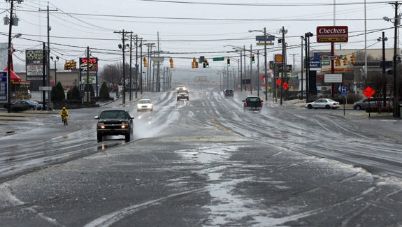 Traffic on Broad Street at Medical Center Parkway Monday, Feb. 16, 2015 during icy weather conditions in Murfreesboro.