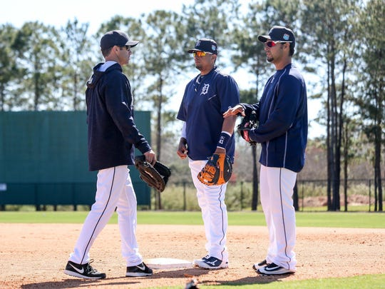 Tigers manager Brad Ausmus walks to first base to talk to Victor Martinez, center, and Anibal Sanchez, right, during spring training. He needs both to return to health and recapture at least some of their old form.