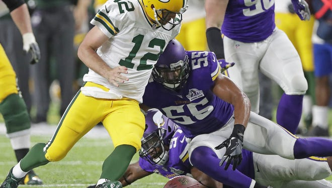 Green Bay Packers quarterback Aaron Rodgers tries to recover his fumble after being stripped on a scramble against the Minnesota Vikings outside linebacker Anthony Barr (55) at U.S. Bank Stadium on Sept. 18, 2016.