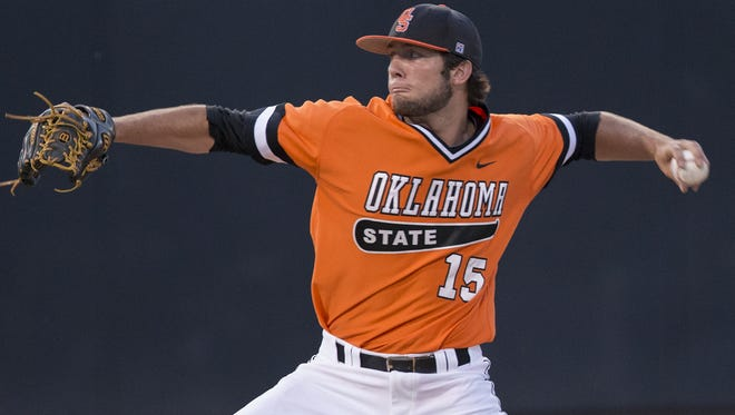 Former Calvary pitcher Garrett Williams, shown pitching for Oklahoma State, was taken in the seventh round by the San Francisco Giants.