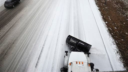 A Tennessee Department of Transportation salt truck works along I-65 at Armory Drive in Nashville, Tenn. on Monday, Feb. 16, 2015. Weather forecasters are urging motorists across most of Tennessee to stay off roads unless it's an absolute emergency. (AP Photo/The Tennessean, Samuel M. Simpkins)  NO SALES