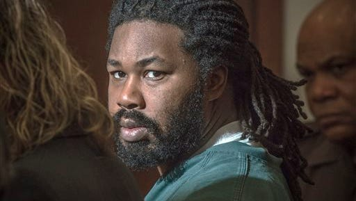 FILE - In this Nov. 14, 2014 file photo Jesse Matthew Jr., right, looks toward the gallery while appearing in court in Fairfax, Va. A prosecutor's decision not to seek a death penalty for Matthew Jr., accused of abducting and killing a University of Virginia student, is emblematic of capital punishment's decline across the country and in Virginia, the state that once operated one of the busiest execution chambers in the nation.