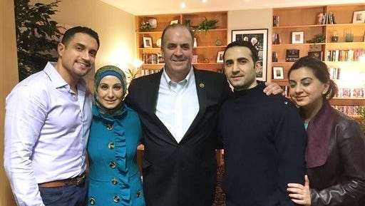 In a Monday, Jan. 18, 2016 photo provided by the Hekmati family, the family and U.S. Rep. Dan Kildee, D-Flint Township, Mich.,meet with former Iran prisoner Amir Hekmati, second from right, at Landstuhl Regional Medical Center in Landstuhl, Germany. From the left: brother-in-law Dr. Ramy Kurdi, sister Sarah Hekmati, Kildee, Amir Hekmati and sister Leila Hekmati. Amir Hekmati was detained in August 2011 on espionage charges. (Courtesy of the Hekmati Family via AP)