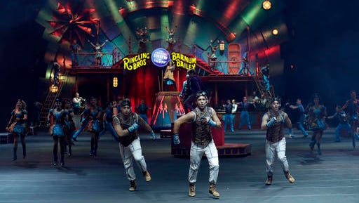 "Ringling Bros. and Barnum & Bailey performers are seen during a show Saturday, Jan. 14, 2017, in Orlando, Fla. The Ringling Bros. and Barnum & Bailey Circus will end the ""The Greatest Show on Earth"" in May, following a 146-year run of performances. Kenneth Feld, the chairman and CEO of Feld Entertainment, which owns the circus, told The Associated Press, declining attendance combined with high operating costs are among the reasons for closing."