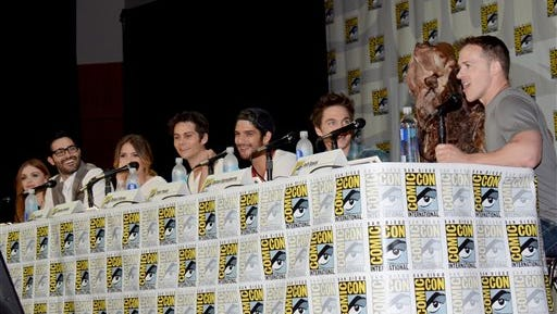 "From left, Holland Roden, Tyler Hoechlin, Shelley Hennig, Dylan O'Brien, Tyler Posey, Dylan Sprayberry and Jeff Davis attend the MTV ""Teen Wolf"" panel on Day 1 of Comic-Con International on Thursday."