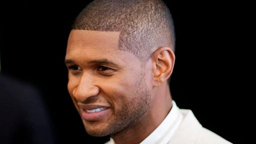"""R&B singer Usher attends the 15th anniversary celebration of his New Look Foundation, Thursday in Atlanta. Usher felt overwhelmed by the amount of supporters at his New Look Foundation's 15th year anniversary luncheon. Legendary boxer Sugar Ray Leonard, director Kenny Leon and producer Jermaine Dupri were among the 450-plus attendees at foundation's President's Circle Awards luncheon in downtown Atlanta on Thursday. The nonprofit organization founded by the Grammy-winning singer also celebrated raising $1 million. """"This is a passion fuel for me,"""" Usher said Thursday."""