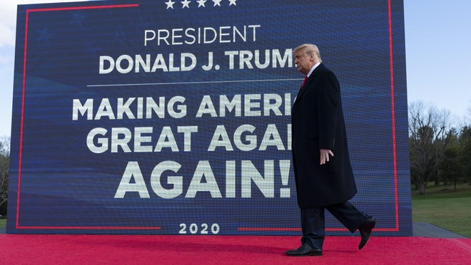 President Donald Trump walks to the podium to speak at a campaign rally at Keith House, Washington's Headquarters, Saturday, Oct. 31, 2020, in Newtown, Pa.