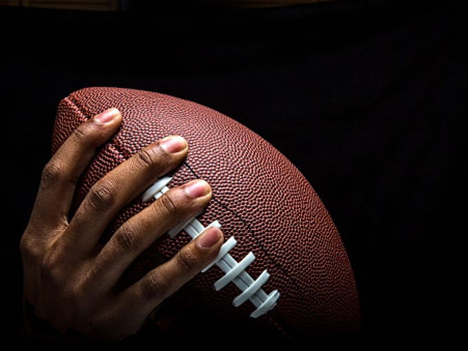 Hand Gripping Football to Pass