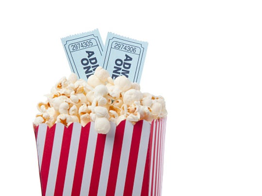 Red Striped Popcorn Bag And Movie Ticket On White Background