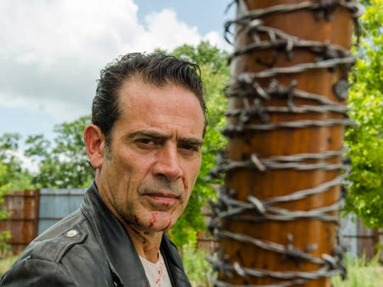 """This image released by AMC shows Jeffrey Dean Morgan as Neganfrom the series, """"The Walking Dead."""" The popular zombie series makes its midseason return Sunday on AMC."""