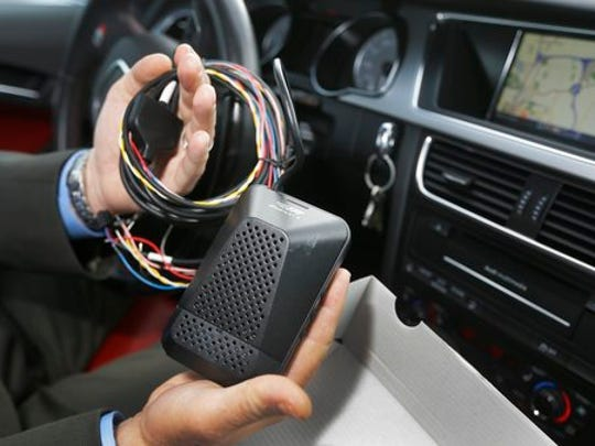 FILE - This Wednesday, Oct. 14, 2015, file photo shows a Mobileye camera system that can be installed in your car to monitor speed limits and warn drivers of potential collisions, mounted behind the rearview mirror during a demonstration of the system, in Ann Arbor, Mich. For a few hundred dollars, drivers can add new safety technology, like forward collision warning systems or backup cameras, to older cars. Cars are lasting longer than ever thanks to improving quality. The average U.S. vehicle is now 11.6 years old, according to the consulting firm IHS Markit.