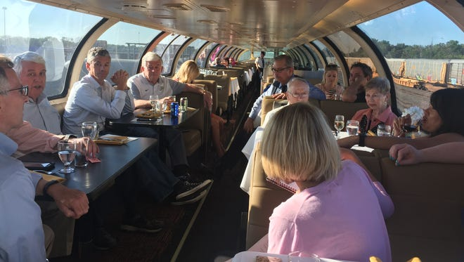 Members of Greater Lafayette Commerce's Quality of Life Council discuss what they saw during a day trip to Chicago on Wednesday aboard the Hoosier State train.