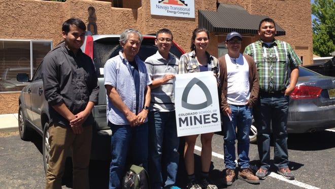 From left, Navajo Transitional Energy Co.'s Kevin Felix, Colorado School of Mines associate professor Masami Nakagawa, graduate students Qifei Niu, Luci Dunnington, Juan Hurtado and NTEC's Sam Woods stand outside NTEC's offices in Farmington on July 12.