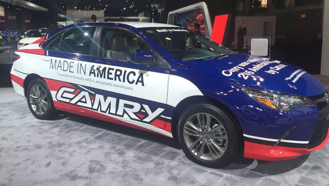 A Toyota Camry, assembled in Georgetown, Ky., is painted up to highlight its American parts and assembly on the floor of the New York Auto Show in April 2017.