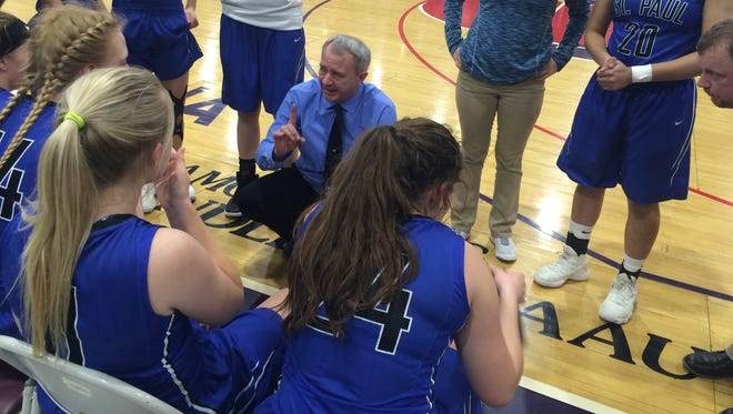 St. Paul girls basketball coach Dave Matlock addresses his team during a timeout Saturday in the state semifinals.