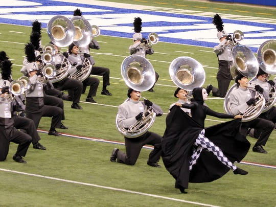 The brass section performs during Grand National Competition in Indianapolis.