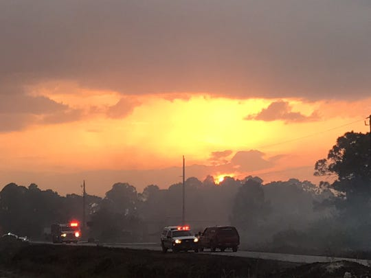 Smoke from a 10-acre brush fire in Lehigh Acres enhanced the sunset Sunday night.