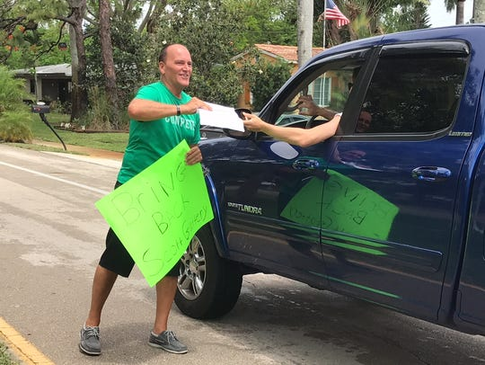 Sean Shores, father of a Fort Myers High school student-athlete, collected signatures in support of the school's basketball coach, Scott Guttery, after he was placed on administrative leave. Guttery eventually resigned as coach and took a job at Evangelical Christian School.