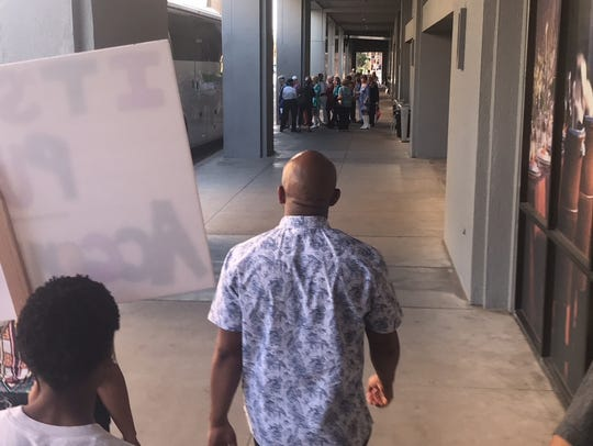 Maupin leads the group through downtown Phoenix streets