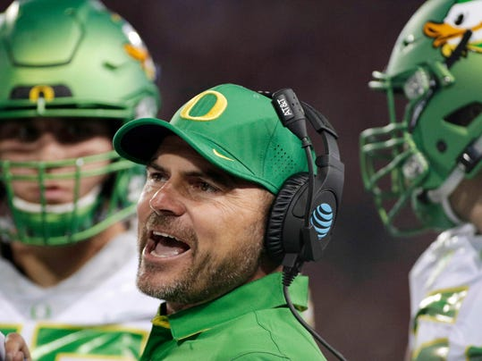 FILE - In this Oct. 1, 2016, file photo, Oregon head coach Mark Helfrich instructs his team during the first half of an NCAA college football game in Pullman, Wash. Oregon fired coach Helfrich Tuesday night, Nov. 29, 2016, after a disappointing 4-8 season, and just two years after getting the Ducks within a victory of the program's first national championship. (AP Photo/Young Kwak, File)