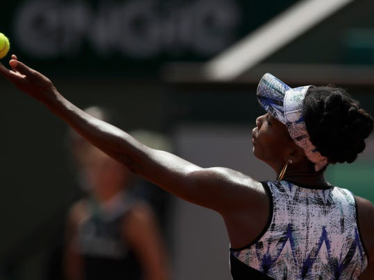 Venus Williams of the U.S. serves against Japan's Kurumi Nara during their second round match of the French Open tennis tournament at the Roland Garros stadium, in Paris, France. Wednesday, May 31, 2017. (AP Photo/Petr David Josek)
