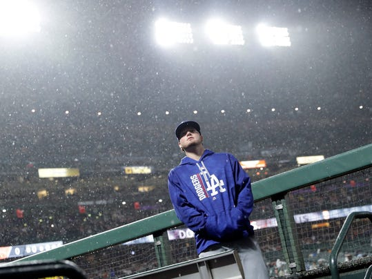 Los Angeles Dodgers' Alex Verdugo looks up at the rain during a delay during a baseball game against the San Francisco Giants, Monday, Sept. 11, 2017, in San Francisco. (AP Photo/Marcio Jose Sanchez)