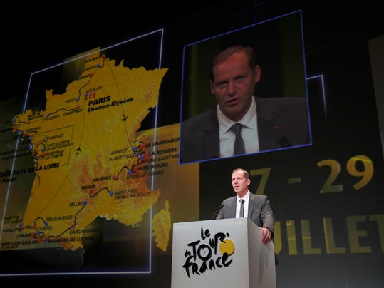 Tour de France director Christian Prudhomme delivers his speech during the presentation of the 2018 Tour de France cycling race, in Paris, Tuesday Oct. 17, 2017. The 105th edition of the race starts on July 7 2018 to end on the Champs-Elysees avenue on July 29. (AP Photo/Christophe Ena)