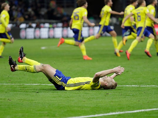 Swedish players react to their qualification at the end of the World Cup qualifying play-off second leg soccer match between Italy and Sweden, at the Milan San Siro stadium, Italy, Monday, Nov. 13, 2017. (AP Photo/Luca Bruno)