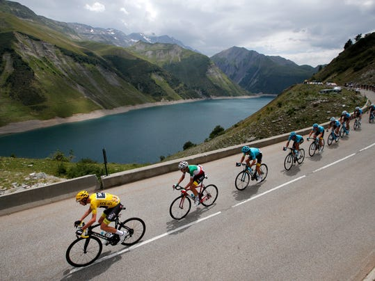 2017 AP YEAR END PHOTOS - Britain's Chris Froome, wearing the overall leader's yellow jersey, is followed by Italy's Fabio Aru as they climb Croix de Fer pass during the seventeenth stage of the Tour de France cycling race over 183 kilometers (113.7 miles) with a start in La Mure and finish in Serre-Chevalier, France, on July 19, 2017. (AP Photo/Christophe Ena)