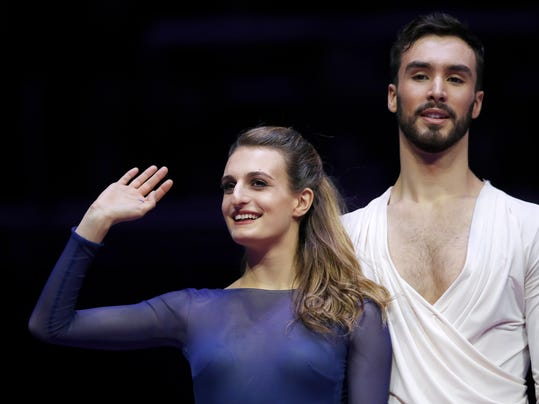 FILE - In a Saturday, Jan. 20, 2018 file photo, France's Gabriella Papadakis and Guillaume Cizeron greet spectators after winning the pairs ice dance free dance event at the European figure skating championships in Moscow, Russia. One of the oddities of figure skating is that training partners are often your biggest rivals.  (AP Photo/Pavel Golovkin, File)