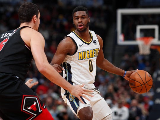 FILE - In this Nov. 30, 2017, file photo, Denver Nuggets guard Emmanuel Mudiay looks for an opening as Chicago Bulls forward Paul Zipser (16) defends in the second half of an NBA basketball game in Denver. Two people with knowledge of the situation say the Denver Nuggets have traded Emmanuel Mudiay to New York and acquired Devin Harris from Dallas in a three-team deal. The Mavericks will get Doug McDermott from New York, the people told The Associated Press on Thursday, Feb. 8, 2018. They spoke on condition of anonymity because the trade could not be completed until it was approved by the NBA. (AP Photo/David Zalubowski, File)