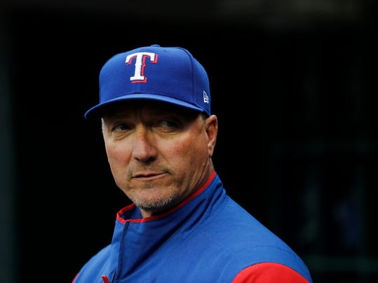 FILE - In this May 20, 2017, file photo, Texas Rangers manager Jeff Banister watches from the dugout in the first inning of a baseball game against the Detroit Tiger in Detroit. Banister is entering his third year as manager of the ball club. (AP Photo/Paul Sancya, File)