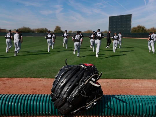 The Chicago White Sox pitchers warmup before drills at the team's spring training baseball facility Saturday, Feb. 17, 2018, in Glendale, Ariz. (AP Photo/Carlos Osorio)