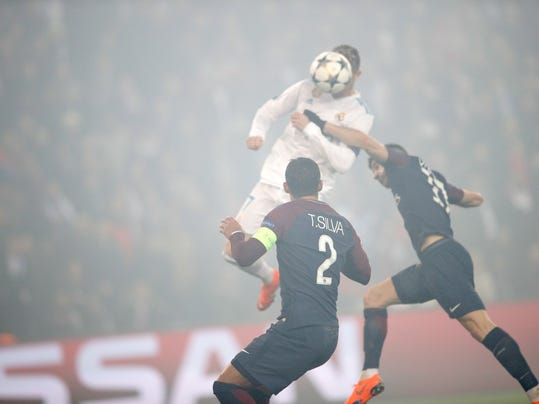 Real Madrid's Cristiano Ronaldo heads the ball to score his side's first goal during the Champions League round of sixteen second leg soccer match between Paris St. Germain and Real Madrid at the Parc des Princes stadium in Paris, France, Tuesday, March 6, 2018. (AP Photo/Christophe Ena)