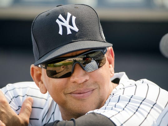 """FILE - In this Feb. 24, 2017, file photo, New York Yankees special advisor Alex Rodriguez speaks with CC Sabathia, who reflected in his sunglasses, ahead of a spring training baseball game against the Philadelphia Phillies in Tampa, Fla. Rodriguez thinks the Yankees' """"breathtaking"""" offense could break records this season. He arrived at spring training Monday, March 19, 2018 and had high praise for a lineup led by Giancarlo Stanton, Aaron Judge, Gary Sanchez and Didi Gregorius. (AP Photo/Matt Rourke, File)"""