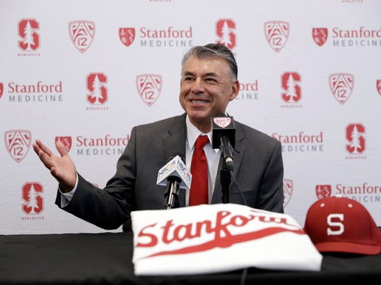FILE - In this June 20, 2017, file photo, David Esquer fields questions during a press conference introducing him as the new head coach of the Stanford NCAA college baseball team, in Stanford, Calif. First-year coach David Esquer has Stanford off to a 17-2 start after a sweep of Southern California in its opening Pac-12 series. The Cardinal outscored USC 34-2 in the three games, including 18-0 on Sunday, March 25, 2018.(AP Photo/Marcio Jose Sanchez)