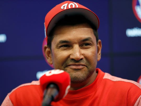 Washington Nationals manager Dave Martinez pauses while speaking during a media availability before a spring exhibition baseball game against the Minnesota Twins at Nationals Park, Tuesday, March 27, 2018, in Washington. (AP Photo/Alex Brandon)