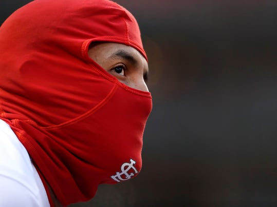 St. Louis Cardinals' Jose Martinez watches from the dugout during the third inning of a baseball game against the Milwaukee Brewers, Monday, April 9, 2018, in St. Louis. (AP Photo/Jeff Roberson)