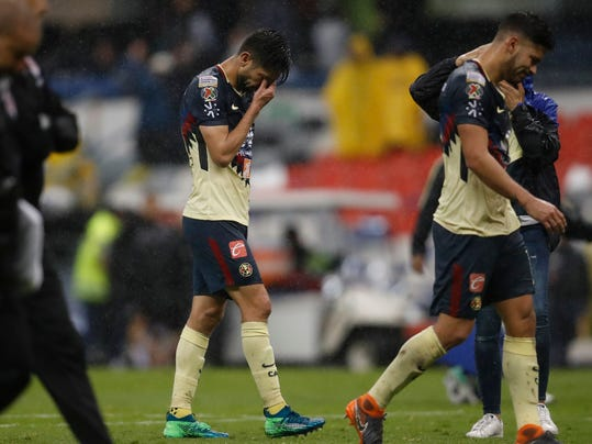 Oribe Peralta of Mexico's America, center, reacts at the end of the second leg of a CONCACAF Champions League soccer semifinal against Canada's Toronto FC, in Mexico City, Tuesday, April 10, 2018. The teams tied 1-1 and Toronto FC advanced on aggregate. (AP Photo/Eduardo Verdugo)