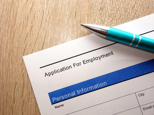 Employment application form and pen on desk