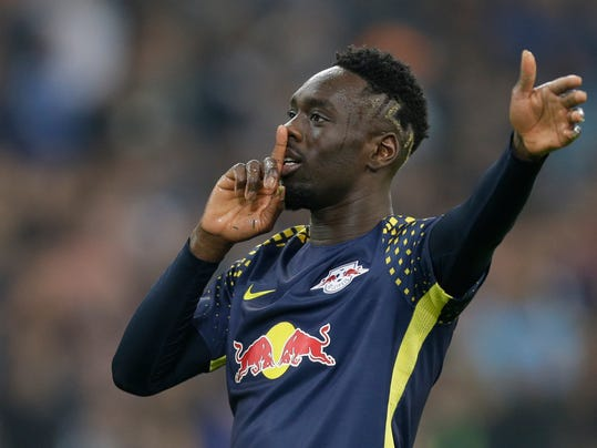 Leipzig's Jean-Kevin Augustin celebrates scoring his side's 2nd goal during the Europa League quarter final second leg soccer match between and Olympique Marseille and RB Leipzig at the Velodrome stadium in Marseille, southern France, Thursday, April 12, 2018. (AP Photo/Claude Paris)