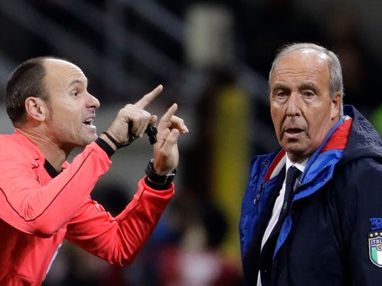 Referee Antonio Mateu Lahoz of Spain gestures when talking to Italy coach Gian Piero Ventura during the World Cup qualifying play-off second leg soccer match between Italy and Sweden, at the Milan San Siro stadium, Italy, Monday, Nov. 13, 2017. (AP Photo/Luca Bruno)