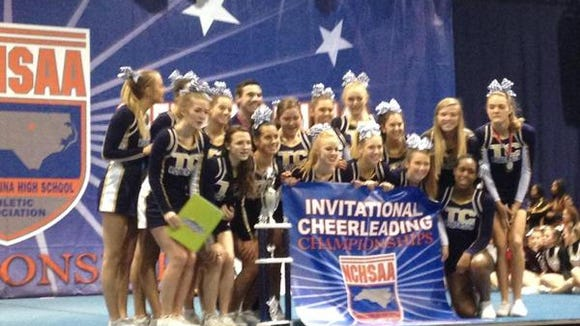Roberson's cheerleading team after its NCHSAA state championship in 2014.