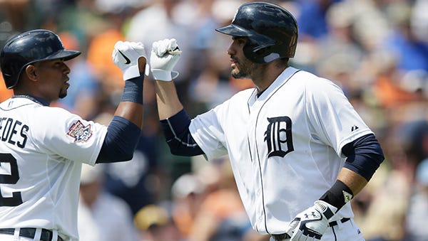 J.D. Martinez is congratulated by Yoenis Cespedes after Martinez's solo home run in the first inning Saturday.