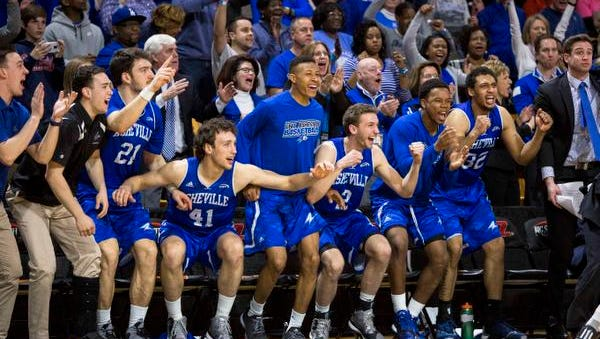 UNC Asheville players show their excitement during the final seconds of Sunday's win in the Big South championship game.