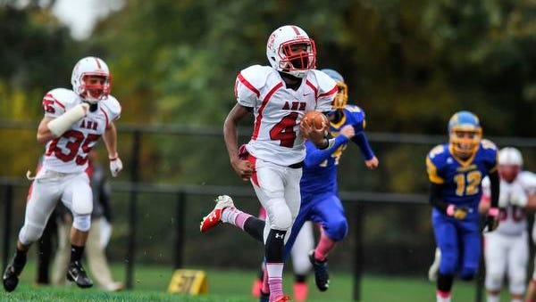 Bishop Ahr's Reminiss Funderburk returns the opening kickoff for a touchdown against Spotswood during their game in Spotswood on Oct. 22, 2016