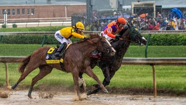 Good Magic comes around the outside of turn three during 144th running of the Kentucky Derby Saturday, May 5, 2018 in Louisville Kentucky.