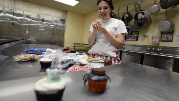 Lizzi Lenhart began her Bake With Lizzi business while at Bay Port High School and has had a booth at the Farmers' Market On Broadway the past two years. She's attending college but intends to expand the business after graduating.